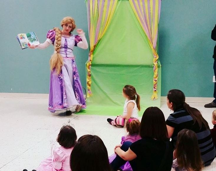Princess Rapunzel reading to children